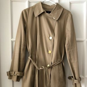 Tan knee-length trench